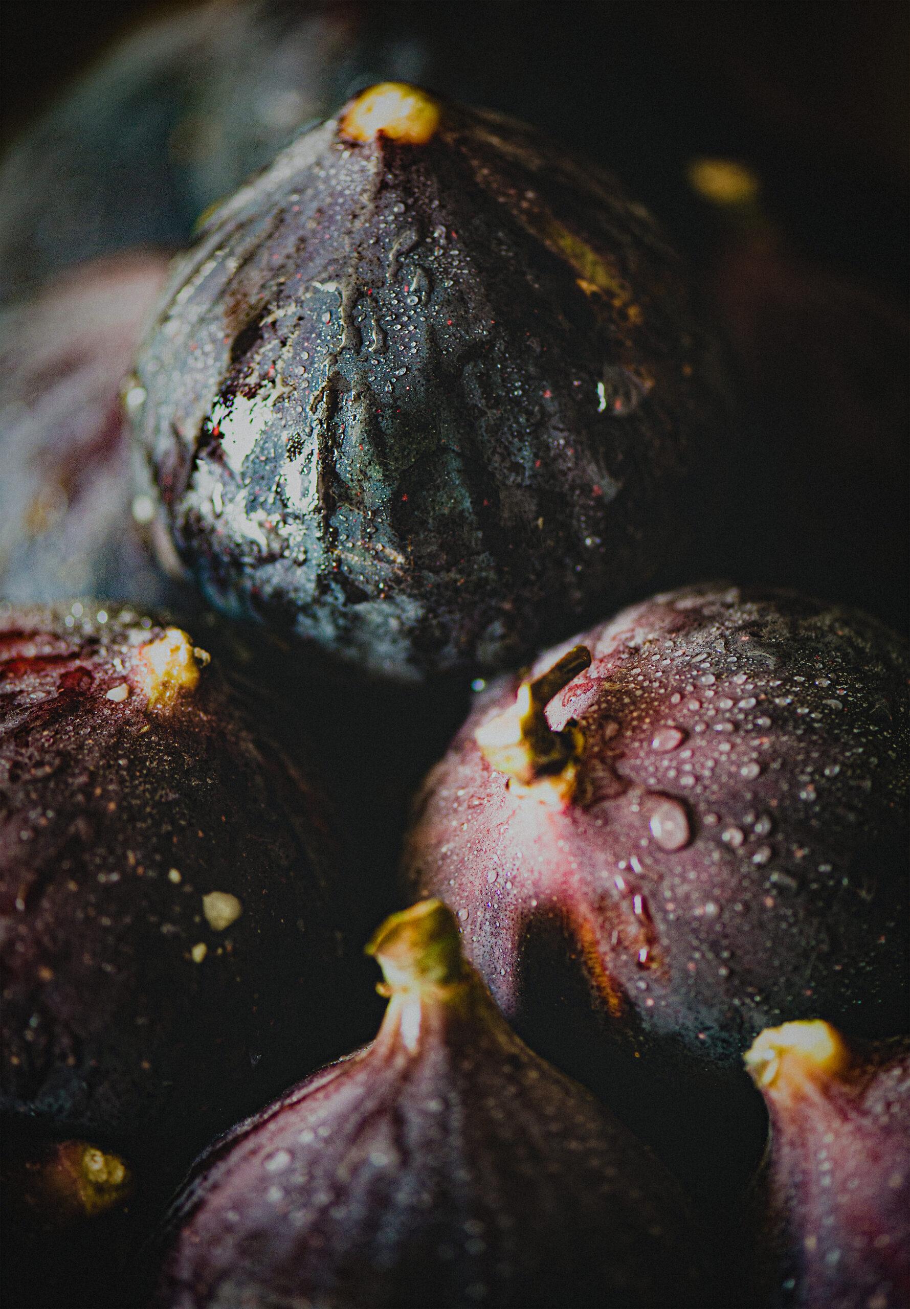 Fresh ripe seasonal harvested wet purple figs, selective focus, close-up